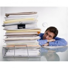 man-at-desk-overwhelmed-with-a-stack-paper-300x300