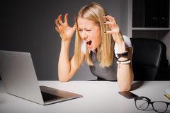 woman-looking-computer-going-crazy-shock-64516401